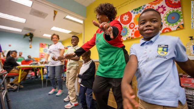 Children and volunteers dance at Roberta's House.