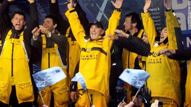 Peyron and his crew celebrate their success in claiming the Jules Verne Trophy in 2012 for the fastest circumnavigation of the world.