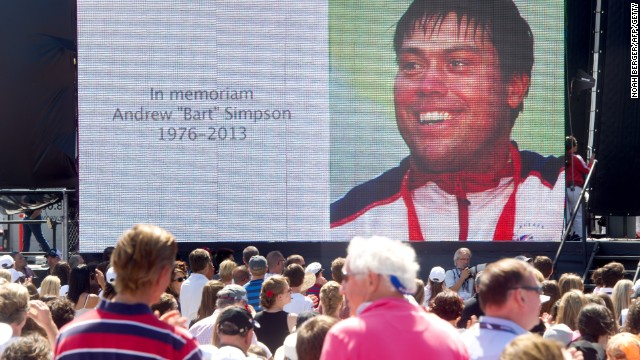A big screen portrays a memorial for tragic Artemis Racing and GB sailor Andrew Simpson who died in a training accident ahead of the 2013 America's Cup.
