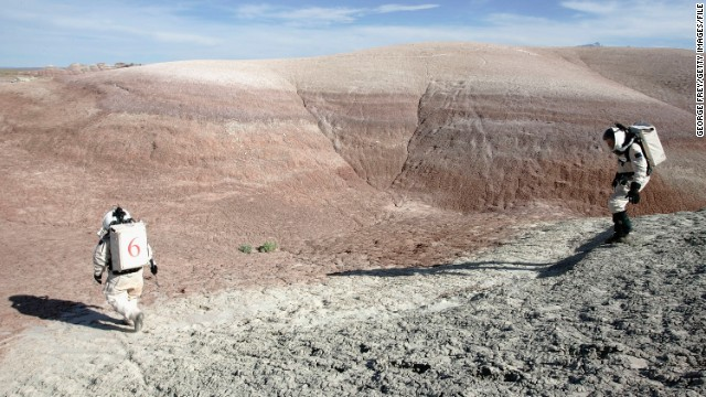 "Could humans walk on Mars? NASA chief scientist, Dr Ellen Stofan, wants to land people on the ""Red Planet"" by the mid-2030s. It's likely to be tougher than this image of researchers at the Mars Desert Research Station in Utah, sponsored by the Mars Society."