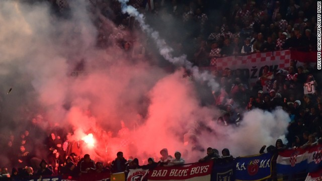 Croatian supporters throw flares on the pitch during their side's Euro 2016 qualifier against Italy at the San Siro.