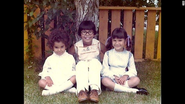 I pose for a snapshot with Darlene and Sheila under a tree in our backyard, wearing our Sunday best. Don't trust the angelic smiles.