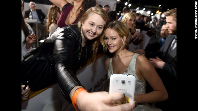 "Actress Jennifer Lawrence, right, poses with fan Chelsea Boyce at the release of the latest ""Hunger Games"" movie Monday, November 17, in Los Angeles."