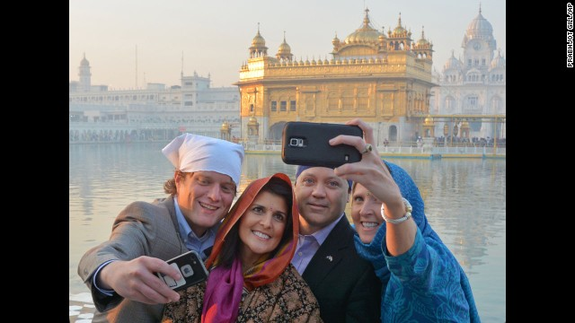 South Carolina Gov. Nikki Haley, second from left, poses in front of the Golden Temple, a Sikh holy shrine, during a visit to Amritsar, India, on Saturday, November 15. Haley's parents are Indian immigrants.