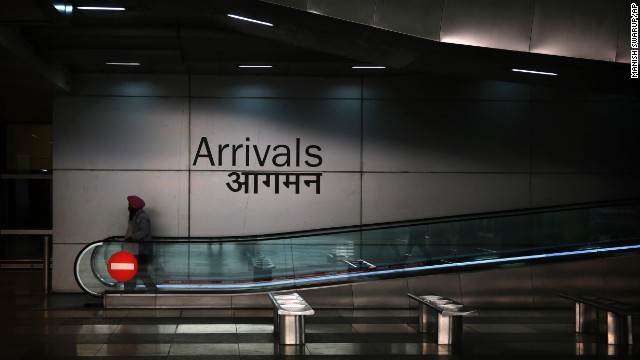 A man in New Delhi moves down the escalator at the arrivals section of the Indira Gandhi International Airport on Wednesday, November 19. A 26-year-old Indian man who recovered from Ebola in Liberia was placed in isolation at the New Delhi airport after traces of the virus were found in his semen, according to India's Health Ministry.