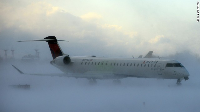 A plane negotiates its way through the snow at Buffalo Niagara International Airport on November 18. All 50 states registered temperatures below freezing Tuesday morning.