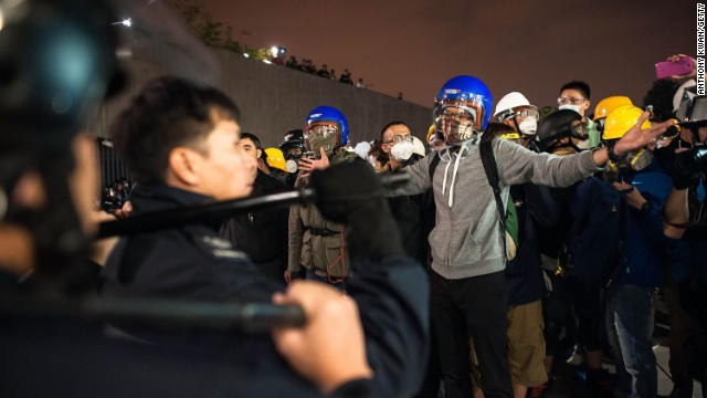 Protesters stand off with police officers outside the Legislative Council building after clashes on November 19.