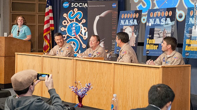 From left, NASA's Kate Squires leads a panel discussion with NASA pilots Hernan Posada, Tom Miller, Manny Antimisiaris and Scott Howe.