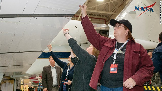 Attendee Trina Phillips (right) inspects an adaptive compliant trailing edge flap on a Gulfstream III flight research support aircraft.
