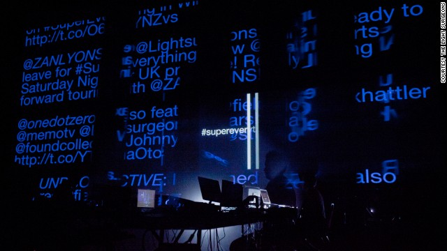 "Live performers combine documentary footage, motion graphics, and original music production on-the-fly to create <a href='http://www.lightsurgeons.com/art/supereverything/' target='_blank'>""a poetic audio visual tapestry.""</a>"
