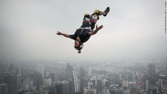 "A base jumper leaps from the 980-foot open deck of Malaysia's Kuala Lumpur Tower. Base jumping is an extreme sport in which participants leap from fixed objects and use parachutes to slow their falls. CNN's ""Wish You Were Here"" series takes you inside the lives of adventurous people all over the world."