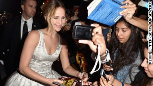 LOS ANGELES, CA - NOVEMBER 17: Actress Jennifer Lawrence poses for a selfie with fans at the premiere of Lionsgate's 'The Hunger Games: Mockingjay - Part 1' at Nokia Theatre L.A. Live on November 17, 2014 in Los Angeles, California. (Photo by Kevin Winter/Getty Images)