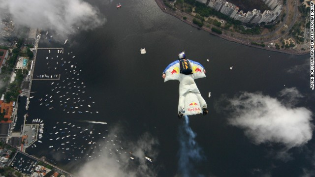 Switzerland's Ueli Gegenschatz flies over Botafogo Bay in Rio de Janeiro. The special wingsuit he's wearing allows skydivers and base jumpers to soar through the sky with their arms spread open.