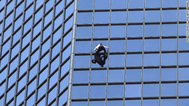 "Alain Robert, known as the ""French Spider-Man,"" scales a 610-foot skyscraper in Paris' La Defense district. Often forgoing ropes and harnesses, Robert has established himself as one of the world's best free solo climbers. He has racked up numerous arrests and a few serious injuries along the way."