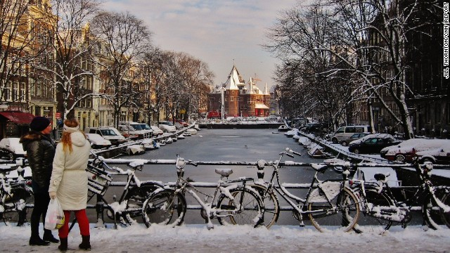 The Oude Kerk stands just beyond an icy bridge in Amsterdam. The 800-year-old building was constructed in the early fourteenth century as a Roman Catholic church, but also has Protestant influences in its architecture.