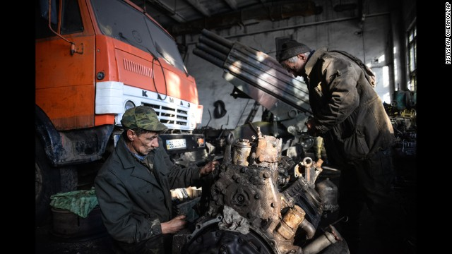 Men repair an engine at the military base in Perevalsk, Ukraine, on Wednesday, November 5.