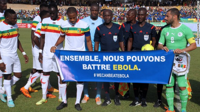 Mali's team captain Seydou Keita (C) and Algeria's captain Medhi Lacen hold a banner reading ''Together we can fight Ebola'' during Africa Cup of Nations qualifying.