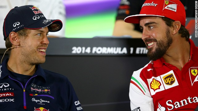 Swapping sides: Fernando Alonso (right) is leaving Ferrari but he will be replaced in 2015 by Red Bull's four-time world champion Sebastian Vettel (left).