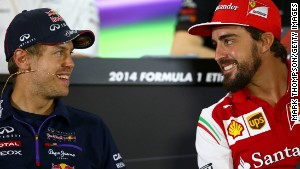 ABU DHABI, UNITED ARAB EMIRATES - NOVEMBER 20: Fernando Alonso of Spain and Ferrari smiles with Sebastian Vettel of Germany and Infiniti Red Bull Racing during the drivers' press conference during previews ahead of the Abu Dhabi Formula One Grand Prix at Yas Marina Circuit on November 20, 2014 in Abu Dhabi, United Arab Emirates. (Photo by Mark Thompson/Getty Images)