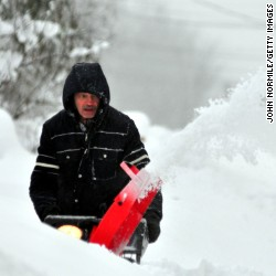Ron Lelito attempts to remove some of the five feet of snow from a driveway on November 20, 2014 in the Lakeview neighborhood of Buffalo, New York.