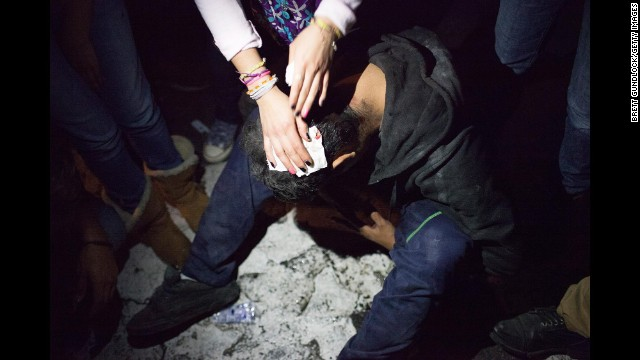 An injured protester gets first aid in Mexico City.