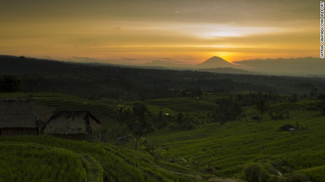 The morning sun warms the <a href='http://whc.unesco.org/en/list/1194' target='_blank'>Jatiluwih Rice Terrace</a> in Bali, <a href='http://ireport.cnn.com/docs/DOC-1170784'>Indonesia</a>. Mount Agung, the highest point on the island, rests in the background.
