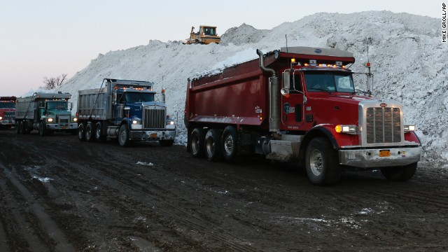 Dump trucks wait to unload snow that was removed from south Buffalo, New York, neighborhoods on Friday, November 21. A ferocious storm dumped massive piles of snow on parts of upstate New York, trapping residents in their homes and stranding motorists on roadways, as snowstorms and record-low temperatures hit much of the country this week.