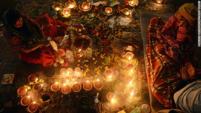NOVEMBER 21 - KATHMANDU, NEPAL: Nepalese Hindu devotees light oil lamps in memory of deceased family members during the Bala Chaturdashi festival at the Pashupatinath Temple. Devotees sow seven kinds of seeds around temple premises in the name of those who have passed away.