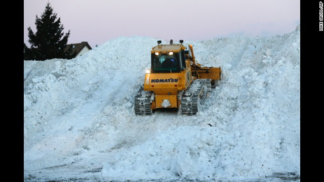 Heavy equipment moves snow at the Central Terminal that was removed from south Buffalo neighborhoods on Friday, November 21, after heavy lake-effect snowstorms.