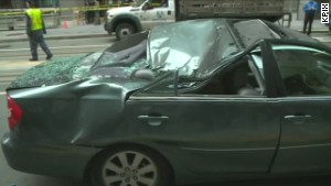 Window washer plunges onto car