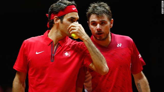 The Swiss pair talk tactics during their doubles match against France's Gasquet and Julien Benneteau.