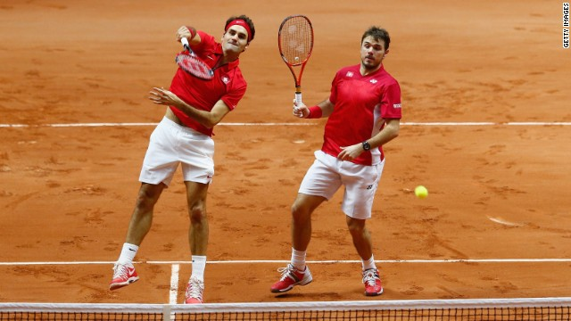 Federer and Wawrinka won their doubles match Saturday to come within one rubber of a historic first for Switzerland.