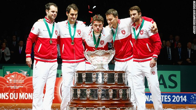 Switzerland got their hands on the Davis Cup for the first time thanks to the efforts of top-10 tennis stars Roger Federer (second left) and Stanislas Wawrinka (center).