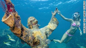 This statue of Christ literally supports marine life