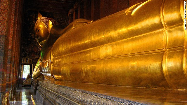 Located in Bangkok Wat Pho temple complex, this reclining Buddha measures 15 meters high and 43 meters long.