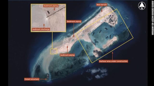 China construye una isla con capacidad militar en aguas en disputa