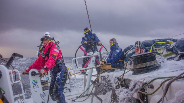 Caffari (at the helm) is the first woman to have sailed single-handedly non-stop around the world in both directions.