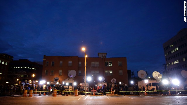 Members of the media line up in a parking lot across from the Buzz Westfall Justice Center on November 24.