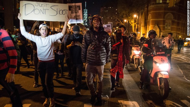 Protesters march through the streets of New York in reaction to the grand jury decision in Missouri.
