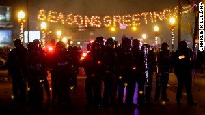 Police in riot gear use tear gas to clear the street in front of the Ferguson, Missouri, Police Department on Monday.