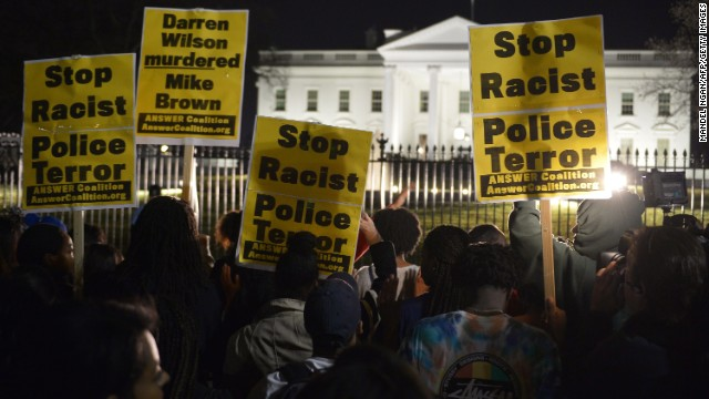 Protesters gather outside the White House.