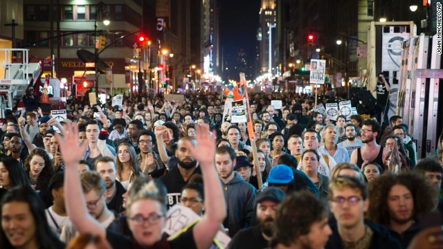 Protesters march up New York's Seventh Avenue on Monday, November 24.