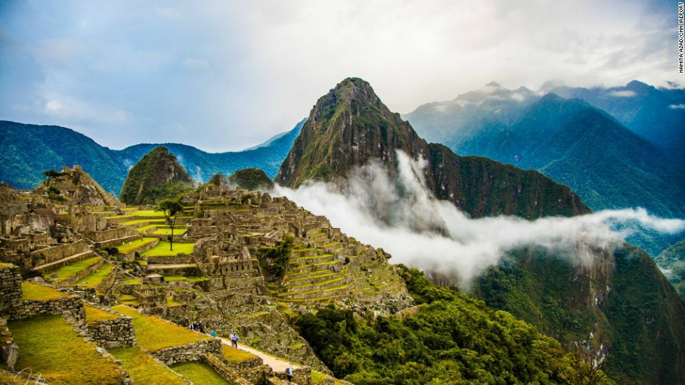"""<a href='http://ireport.cnn.com/docs/DOC-1169557'>Namita Azad</a> hiked through misty Machu Picchu, Peru, on a visit back in August. """"As the minutes went by, the mist slowly rose and the sun started seeping through, giving it a magical feel,"""" she said."""