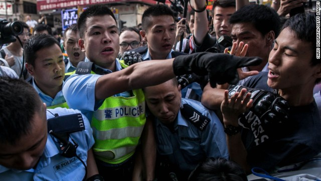 Police clash with protesters as they try to clear a major protest site on Tuesday, November 25.