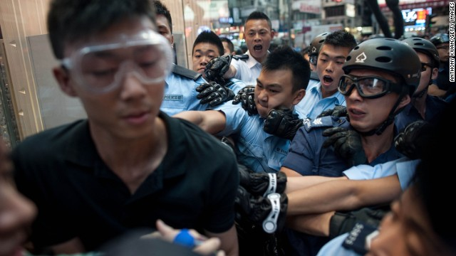Police try to arrest a protester on November 25.