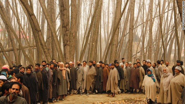 NOVEMBER 25 - SHADIPORA, INDIAN-CONTROLLED KASHMIR: Voters stand in a queue outside a polling station at Shadipora, on the outskirts of Srinagar, waiting to cast their ballots in the Jammu and Kashmir state assembly elections. Muslim separatist groups have called for a voting boycott.