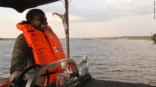 Connie, a guide at Chobe Game Lodge, behind the wheel of their new electric boat on the Chobe River in Botswana. The lodge has an all-female guiding team.