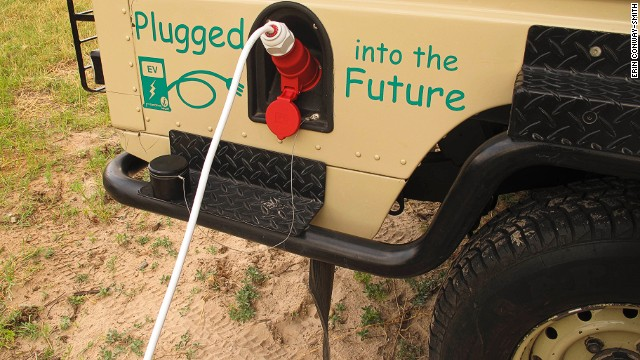 """""""Fueling up"""" the Land Rover, now using electric power from the Victoria Falls hydroelectric grid instead of diesel."""
