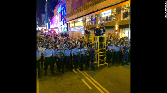 "HONG KONG: ""Police advance with the pepper spray man in the tower. They were not messing around this time and cleared the street. The protesters fell back after a baton charge but I don't think anyone was hurt. A few burning eyeballs though. It's quiet again. A block from here the streets are teeming with shoppers and whatnot like nothing is happening."" - CNN's Brad Olson, November 25. Bailiffs began clearing a major pro-democracy protest site in Hong Kong's bustling Mong Kok district Tuesday, triggering scuffles, arrests and a standoff with growing crowds of protesters. Pro-democracy activist and lawmaker Leung Kwok-hung, commonly known as ""Long Hair,"" was among those arrested, his office confirmed. Hundreds of police were in attendance to support the bailiffs' efforts to remove barriers from Mong Kok's Argyle Street between Tung Choi and Portland Streets. <a href='http://edition.cnn.com/2014/11/25/world/asia/hong-kong-protests-mong-kok-clearance/index.html?hpt=hp_t3'>FULL STORY AT CNN.COM</a>. Follow Brad (<a href='http://instagram.com/cnnbrad' target='_blank'>@cnnbrad</a>) and other CNNers along on Instagram at <a href='http://instagram.com/cnn' target='_blank'>instagram.com</a>."