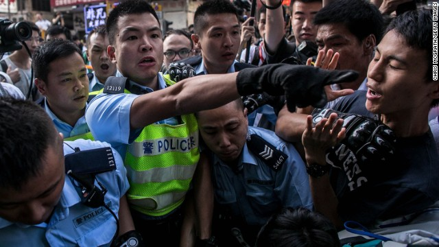 Lawmaker \'Long Hair\' among 80 arrested amid clashes at Hong Kong protest site